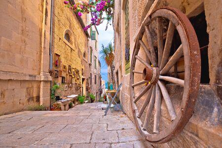 Town of Korcula steep narrow stone street colorful view, archipelago of southern Dalmatia,  Croatia