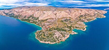 Stara Baska. Aerial panoramic view of Stara Baska village and stone desert landscape of Krk island, Kvarner bay of Croatia 스톡 콘텐츠