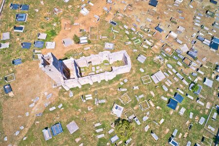 Historic church of Holy Salvation ruins and historic graveyard in Cetina aerial view, pre-romanesque church in Dalmatian hinterland of Croatia