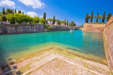 Peschiera del Garda turquoise channel around town walls view, tourist destination on Lago di Garda, northern Italy