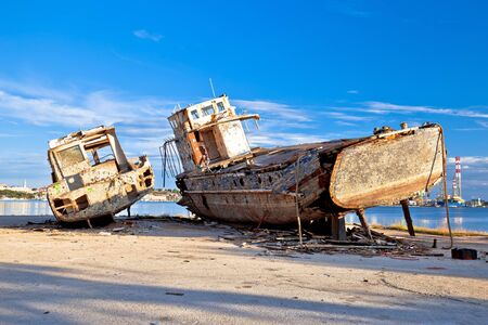 Old wooden boats wreck decay by the sea, Pula, Istria region of Croatia