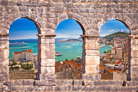 Split waterfront aerial panoramic view through stone window, Dalmatia, Croatia