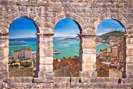 Split waterfront aerial panoramic view through stone window, Dalmatia, Croatia