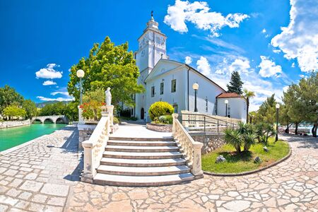 Crikvenica. Church of the Assumption of the Blessed Virgin Mary and Crikvenica waterfront view, Kvarner region of Croatia Standard-Bild