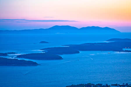 Pakleni Otoci archipelago and Vis island sunset view, Dalmatia region of Croatia Фото со стока