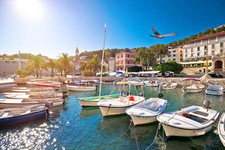 Turquoise waterfront and harbor of old town of Hvar sun haze view, archipelago of Dalmatia, Croatia Banco de Imagens