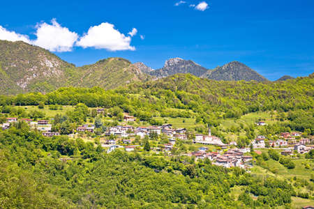 Idyllic village in Dolomites Alps above Garda lake view, Lombardia region of Italy Stock Photo
