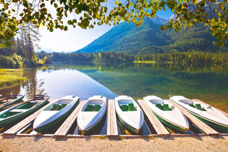 Colorful boats on Hintersee lake in Berchtesgaden Alpine landscape view, Bavaria region of Germany