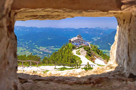 Eagle's Nest or Kehlsteinhaus hideout on the rock above Alpine landscape view through stone window, Berchtesgadener Land, Bavaria, Germany