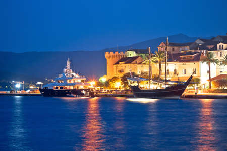 Yacht and wooden sailboat in Korcula harbor evening view, southern Dalmatia archipelago of Croatia