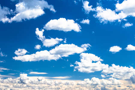 Beautiful bright blue sky with white clouds, nature background