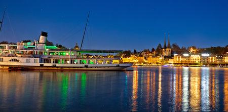 Town of Luzern evening waterfront and boat on Swiss lake Luzern view, central Switzerland Standard-Bild
