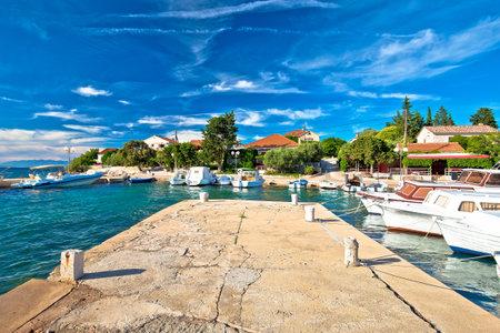 Zadar archipelago. Ugljan village idyllic island harbor and old architecture, Dalmatia region of Croatia