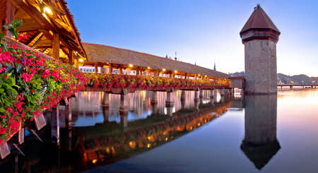 Luzern wooden Chapel Bridge and tower panoramic view, landmark in town in central Switzerland
