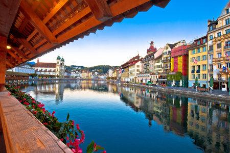 Chappel bridge historic wooden landmark in Luzern and town riverfront view, town in central Switzerland