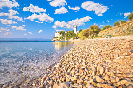 Bol on Brac island. Monastery on pebble beach in Bol view, island of Brac, archipelago of Dalmatia, Croatia