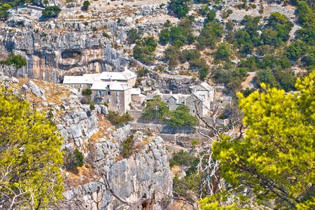 Pustinja Blaca hermitage hidden in stone desert canyon of Brac island, Dalmatia archipelago of Croatia Standard-Bild