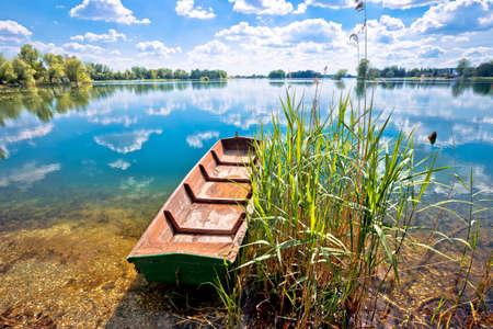 Podravina. Soderica lake wooden boat and water landscape view, Podravina region of Croatia