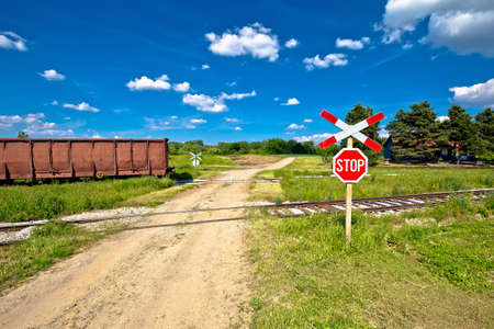 Unprotected railroad crossing country road view.  Podravina region green landscape in northern Croatia