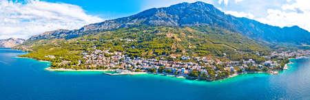 Town of Breal beach and Biokovo mountain aerial panoramic view, Makarska riviera in Dalmatia, Croatia