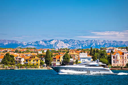 Zadar waterfront and speedboat yacht view, Velebit mountain background, Dalmatia archipelago of Croatia Фото со стока