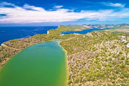 Telascica nature park and green Mir lake on Dugi Otok island aerial view, Kornati archipelago national park of Croatia
