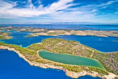 Telascica nature park cliffs and green Mir lake on Dugi Otok island aerial view, Kornati archipelago national park of Croatia