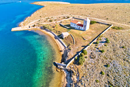 Stone desert island of Zecevo church and pilgrimage aerial view, Zadar archipelago of Croatia