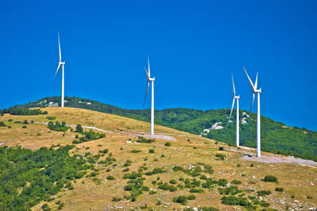 Wind power plant turbines on Velebit mountain region karst, windy area of Croatia Фото со стока