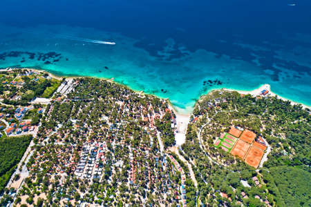 Biograd na Moru idyllic turquoise beach and camp aerial view, Dalmatia region of Croatia