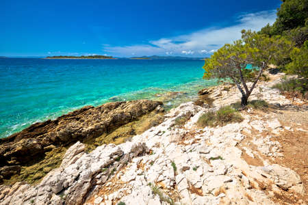 Idyllic turquoise rocky beach landscape view in Zadar riviera, Pakostane in Dalmatia region of Croatia Фото со стока