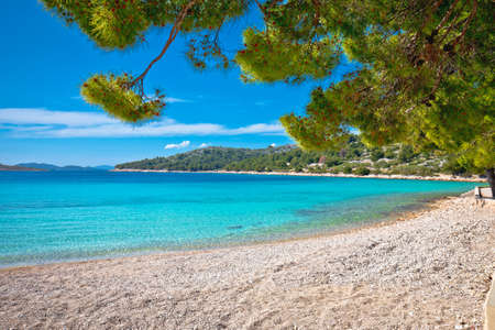 Island of Murter turquoise lagoon beach Slanica, Dalmatia archipelago of Croatia Фото со стока