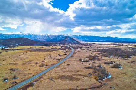 Lika region. Zir hill and Velebit mountain in Lika landscape aerial view. A1 highway. Rural Croatia Фото со стока