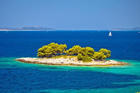 Lonely island in turquoise sea view near Primosten, Dalmatia archipelago of Croatia
