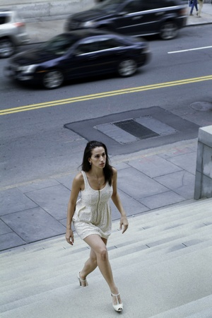 endeavor: A woman forcefully walked up on stairs  Stock Photo