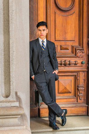 Dressing Formally In Three Pieces Black Suit Patterned Necktie