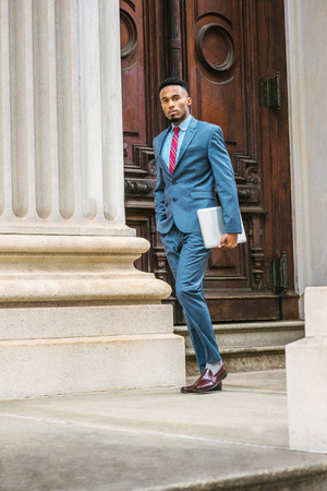 ffe6f61b1f Stock Photo - Young African American Businessman with beard working in New  York, wearing dark sky blue suit, violet red patterned tie, dark purple  leather ...