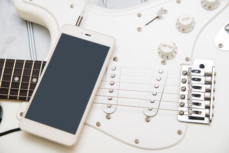 Guitar phone music Stock Photo