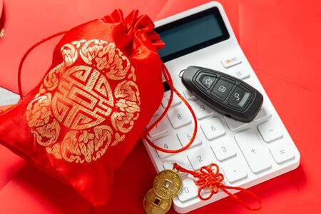 Calculator with chinese wedding candy bag