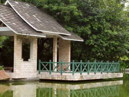 a pavilion surrounded by green trees near the lake in zhujiang park in guangzhou china photo