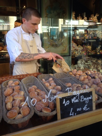 baked  goods: Man selling his baked goods in a bakery shop