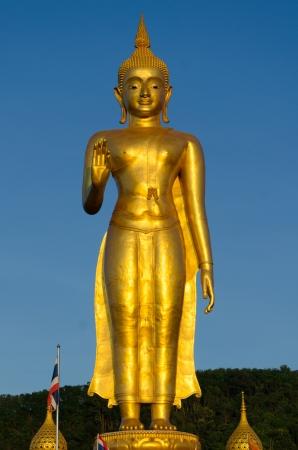 standing gold buddha statue hatyai songkhla thailand stock photo
