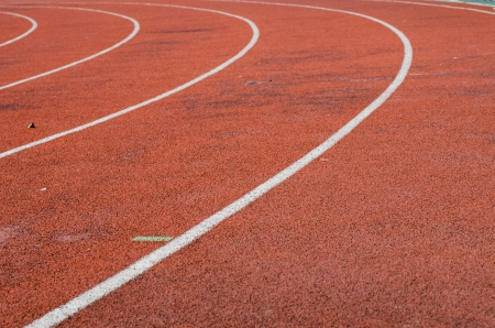 Running track with lane and four white lines photo