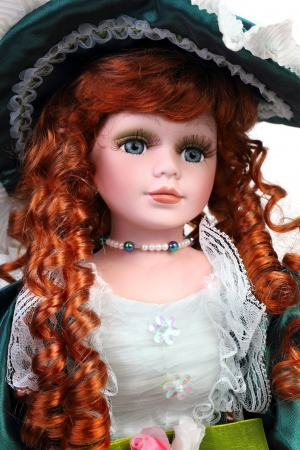 Redhead doll portrait in medieval dress and hat photo