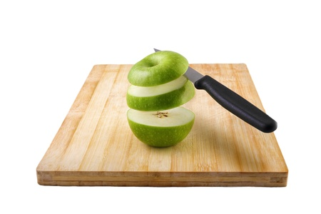 chipped apple on a cutting board with a knife photo