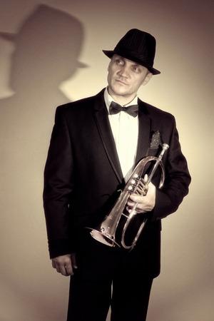 flugelhorn: Stylish trumpeter holding the flugelhorn Stock Photo