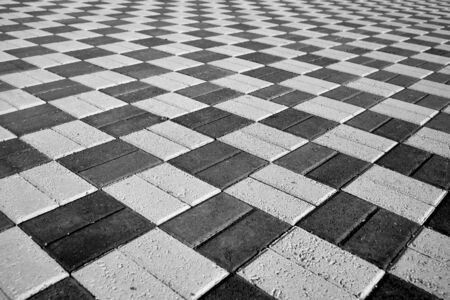 black and white paving stones in perspective shot. High quality photo