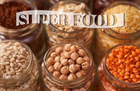 Super food grits in glass jars. Top view. lentils, chickpeas, corn, oats, beans, chia. Very high quality photo