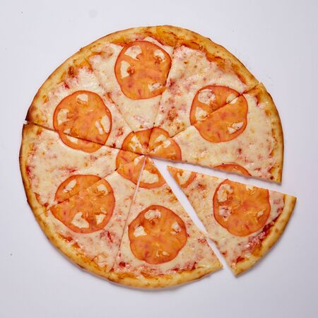 Pizza with cut off slice on a white background. Top view. High quality photo 版權商用圖片