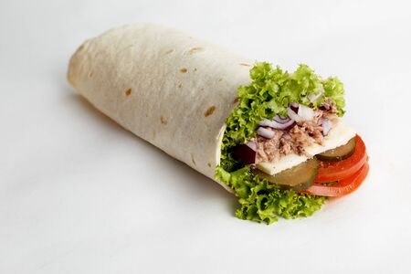 Hot roll with tuna, lettuce, onion, cucumber and tomatoes. High quality photo Stock Photo